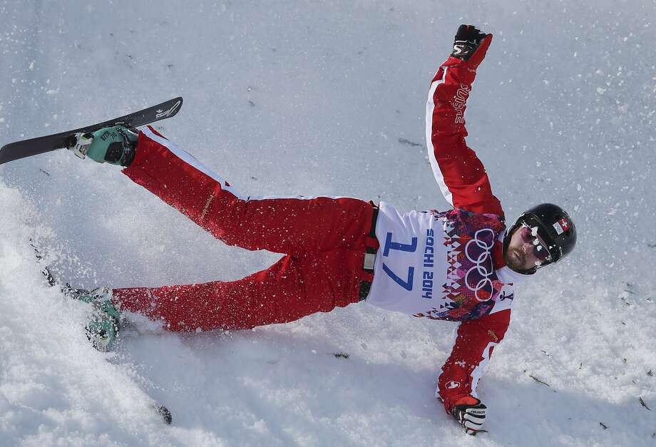 Switzerland's Christopher Lambert crashes during men's freestyle skiing aerials  training at the Rosa Khutor Extreme Park, at the 2014 Winter Olympics, Wednesday, Feb. 12, 2014, in Krasnaya Polyana, Russia. Photo: Sergei Grits, Associated Press