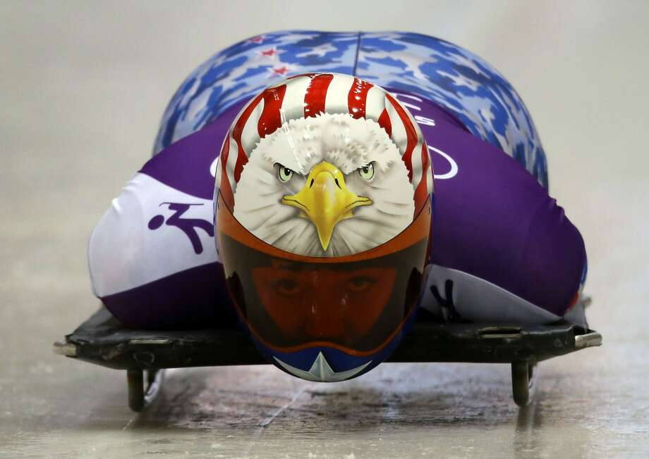 Katie Uhlaender of the United States speeds down the track during the women's skeleton training at the 2014 Winter Olympics, Wednesday, Feb. 12, 2014, in Krasnaya Polyana, Russia. Photo: Dita Alangkara, Associated Press