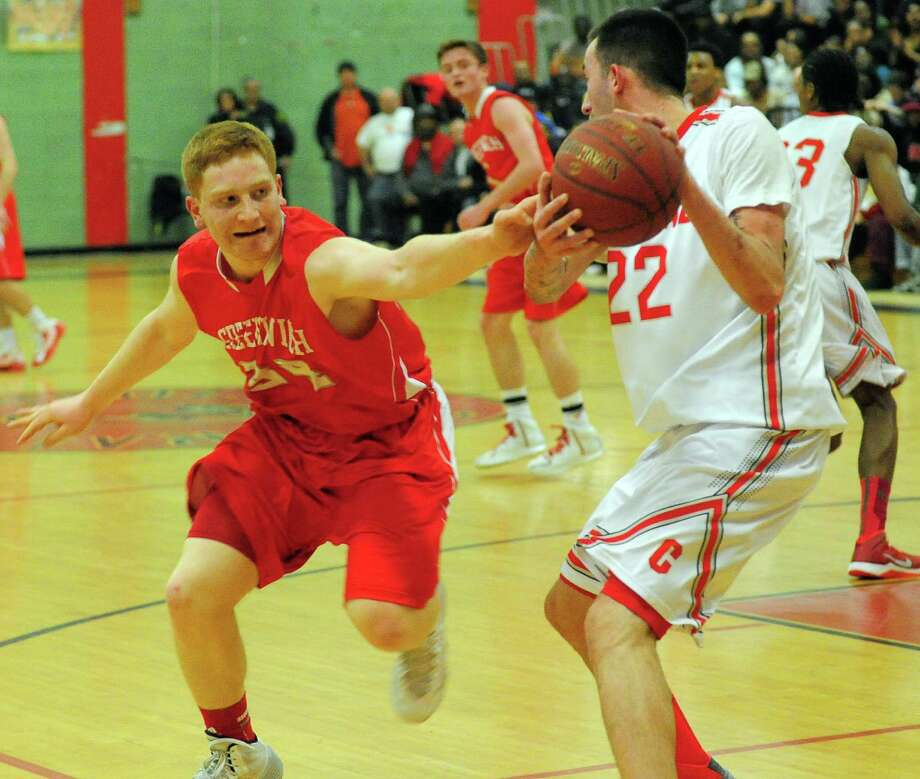 Greenwich's Griffin Golden, left, tries to grab the ball away from Central's Orhan Cecunjamin, during boys basketball action in Bridgeport, Conn. on Tuesday February 11, 2014. Photo: Christian Abraham / Connecticut Post