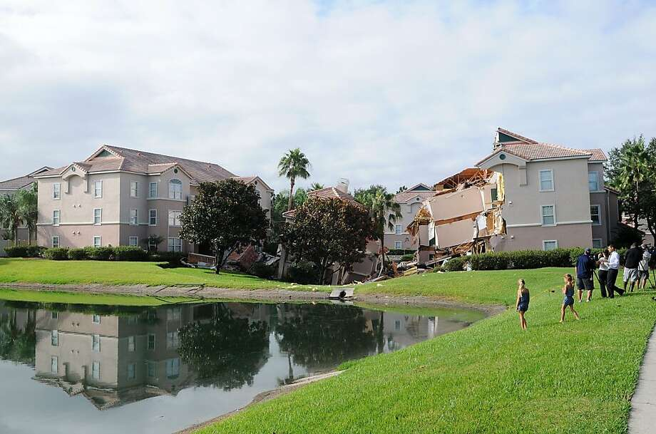 A sinkhole at Summer Bay Resort near Disney World on Monday in Clermont, Florida. The 40 to 60 foot sinkhole opened up under the resort building overnight. There were no injuries or deaths reported. Click through the gallery for more images of this sinkhole and recent sinkholes around the world.(Photo by Gerardo Mora/Getty Images) Photo: Gerardo Mora, Getty Images