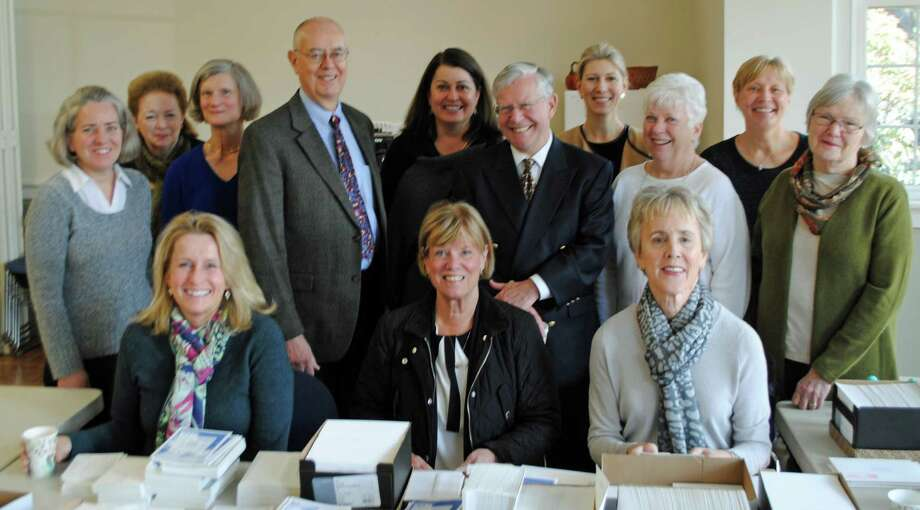 The Darien Antiques Show committee prepares invitations to the preview party. In back row from left, Nicole Casey, Marnie Hodil, Wyn Lydecker, Marc Thorne, Susan Wilson, John Bassler, Mariann Bigelow, Mandy Teare, Judith Sinche and Barbara Thorne; front row, Molly Watkins, Anne MacInnes and Janet Soskin. Photo: Contributed Photo, Contributed / Darien News
