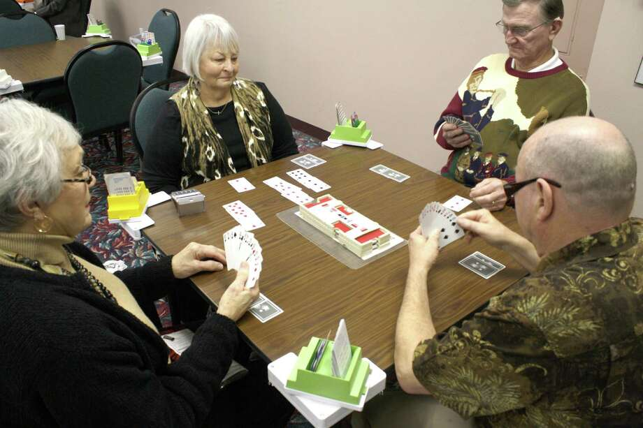 Members of the Beaumont Bridge Studio gather throughout the week to play cards. Saturday, they will a 'Learn to Play Bridge in a Day?' session to teach the basics of Bridge to newcomers. Photo: Jose D. Enriquez III