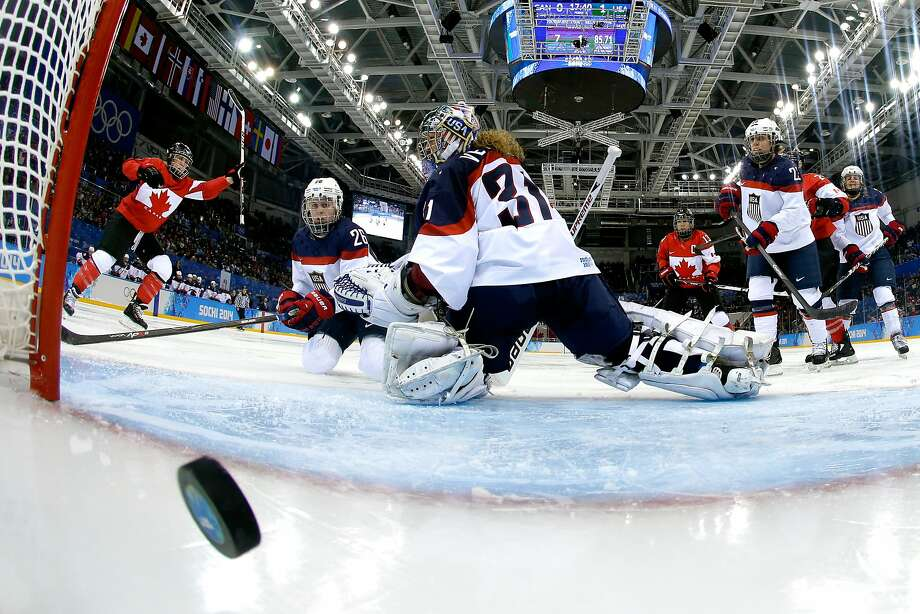 Meghan Agosta-Marciano #2 of Canada celebrates scoring a goal in the third period against Jessie Vetter #31 of the United States during the Women's Ice Hockey Preliminary Round Group A game on day five of the Sochi 2014 Winter Olympics at Shayba Arena on February 12, 2014 in Sochi, Russia. Photo: Pool, Getty Images