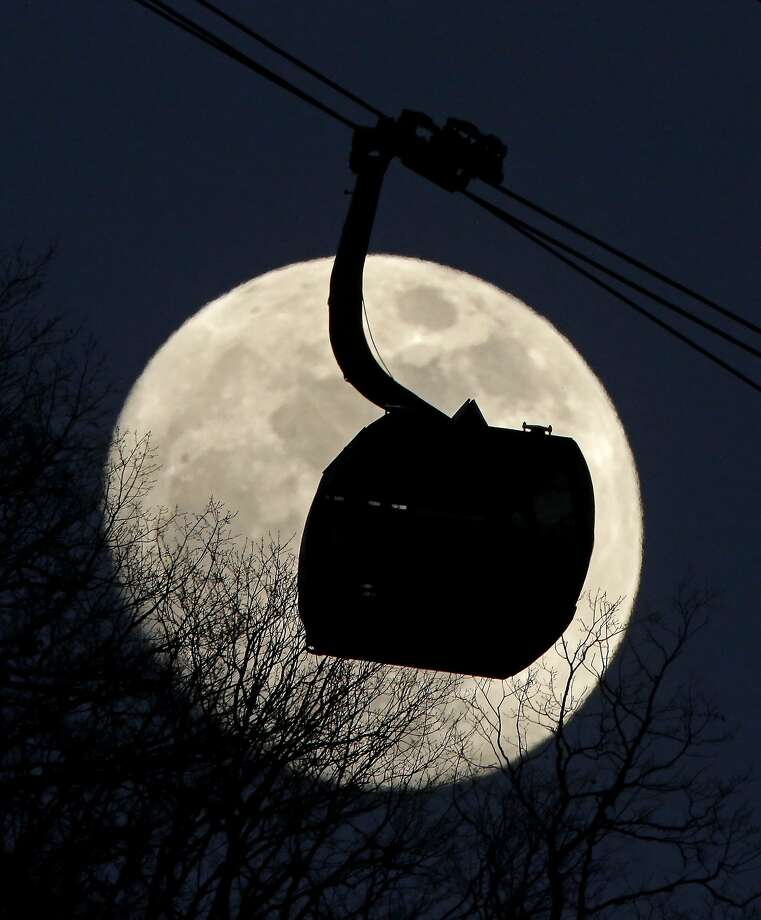 A gondola used to transport people to the biathlon and and cross country skiing venues is silhouetted against the rising moon Wednesday, Feb. 12, 2014, in Krasnaya Polyana, Russia. The area is host to the alpine venues of the 2014 Winter Olympics. Photo: Charlie Riedel, Associated Press