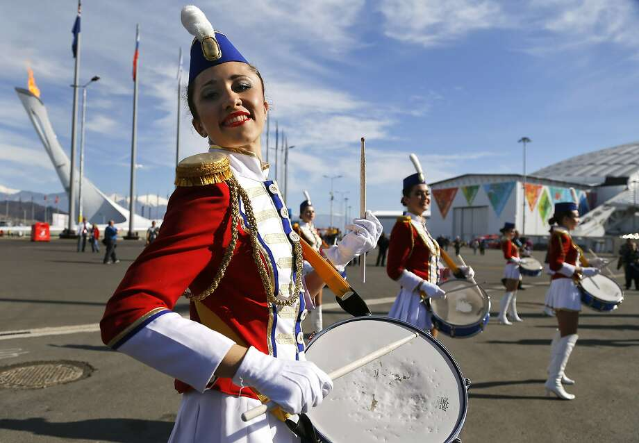 A Russian women's drum corps performs inside Olympic Park at the 2014 Winter Olympics, Wednesday, Feb. 12, 2014, in Sochi, Russia. Photo: Julie Jacobson, Associated Press