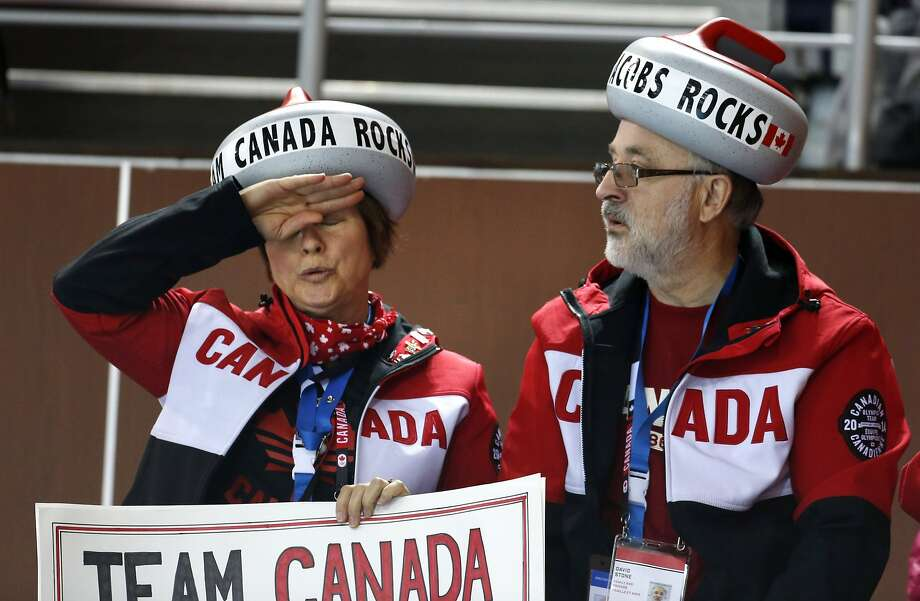 Deborah Stone of Sault Sainte Marie, Ontario, Canada, left, with husband David Stone, wipes her brow moments after Canada's close victory over Great Britain during women's curling competition at the 2014 Winter Olympics, Wednesday, Feb. 12, 2014, in Sochi, Russia. Photo: Robert F. Bukaty, Associated Press