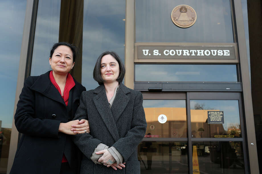 Cleo DeLeon, left, and Nicole Dimetman talk to the media before the hearing for their request for a preliminary injunction to declare Texas' ban on same-sex marriage unconstitutional at the John H. Wood Jr. United States Courthouse in San Antonio on Wednessday, Feb. 12, 2014. The couple was legally married in Massachusetts in 2009. Photo: Lisa Krantz / San Antonio Express-News