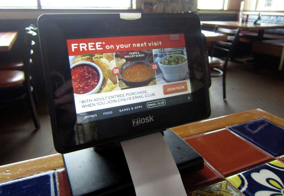A number of Chili's restaurants in the Houston are using Ziosk tablets at tables. Customers can use the devices to order drinks, desserts and pay the bill. Photo: Syd Kearney / ONLINE_YES