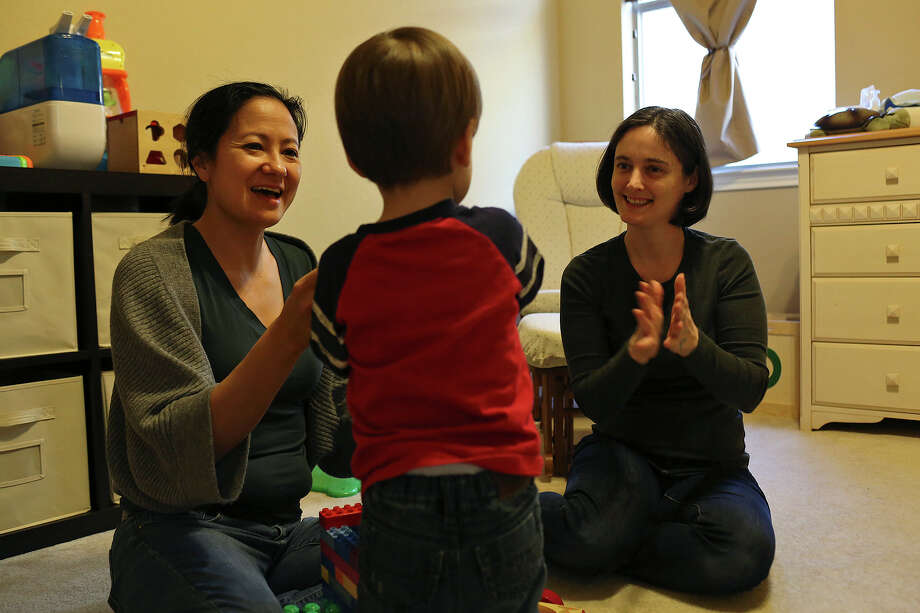 Cleo DeLeon, left, and Nicole Dimetman play with their son at their home in Austin on Saturday, Feb. 8, 2014. Photo: Lisa Krantz, San Antonio Express-News / San Antonio Express-News
