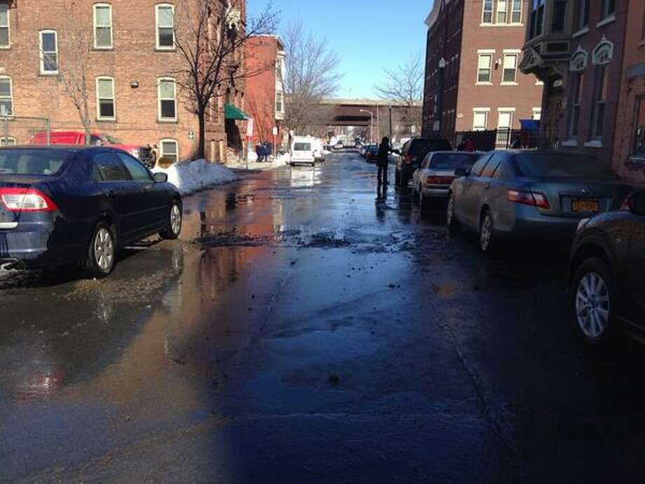 Police said a burst, underground water pipe has made vehicle travel is impossible near Fifth Avenue and Hutton Street in Troy. Water was discovered spurting from the ground shortly before 11:20 a.m. (Lori Van Buren / Times Union)