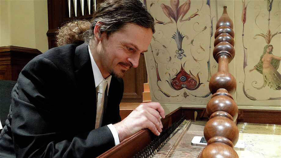 "Aymeric Dupre la Tour, the music director and organist at First Church Congregational, tunes the harpsichord on a break during the Chamber Orchestra of New York's ""Music in the Meetinghouse"" Concert at the church Sunday afternoon. Photo: Mike Lauterborn / Fairfield Citizen contributed"