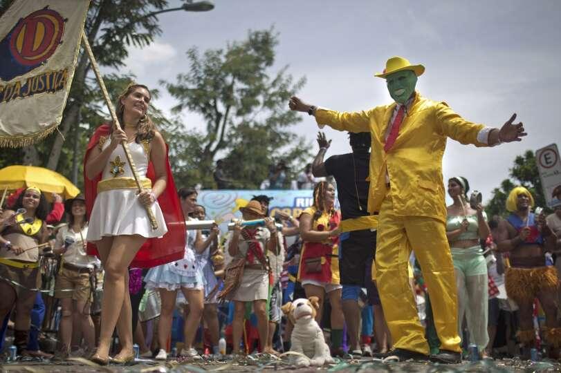 A reveler dressed as superhero The Mask, shows off his moves in the 'Desliga da Justica' carnival bl