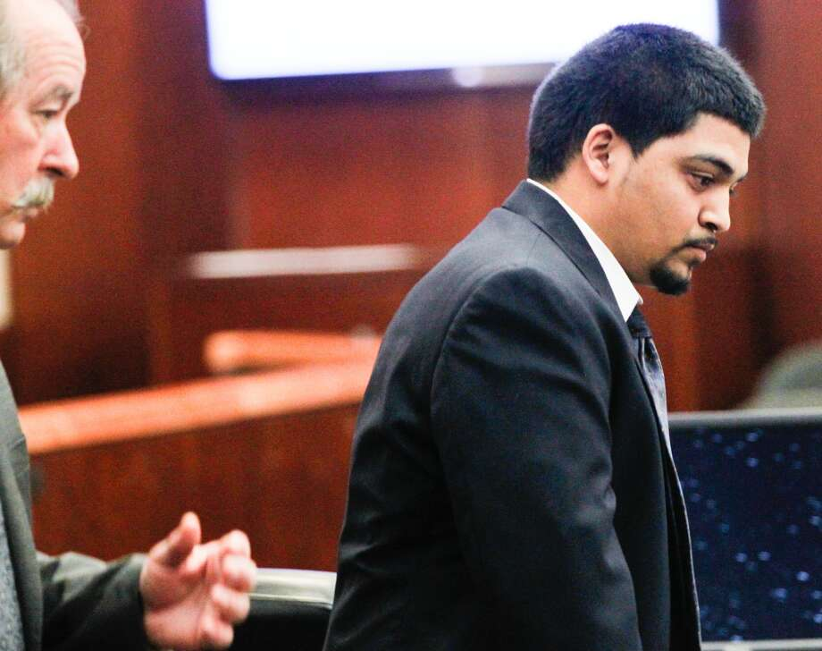 Alfredo Gomez is pictured with his attorney, Feb. 12, 2014. Gomez is the first suspect to go to trial in a bloody shootout that started about 2 p.m. on Nov. 21, 2011.