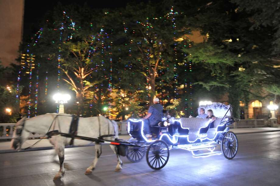 13. HORSE CARRIAGE RIDE: The days of the horse-drawn carriage may be numbered in major American cities like New York and Chicago, but, by golly, they're still legal in San Antonio. Hop on board and see downtown at a leisurely pace. Don't worry, they don't feed them Beef-A-Reno here. Photo: Robin Jerstad, Special To The Express-News