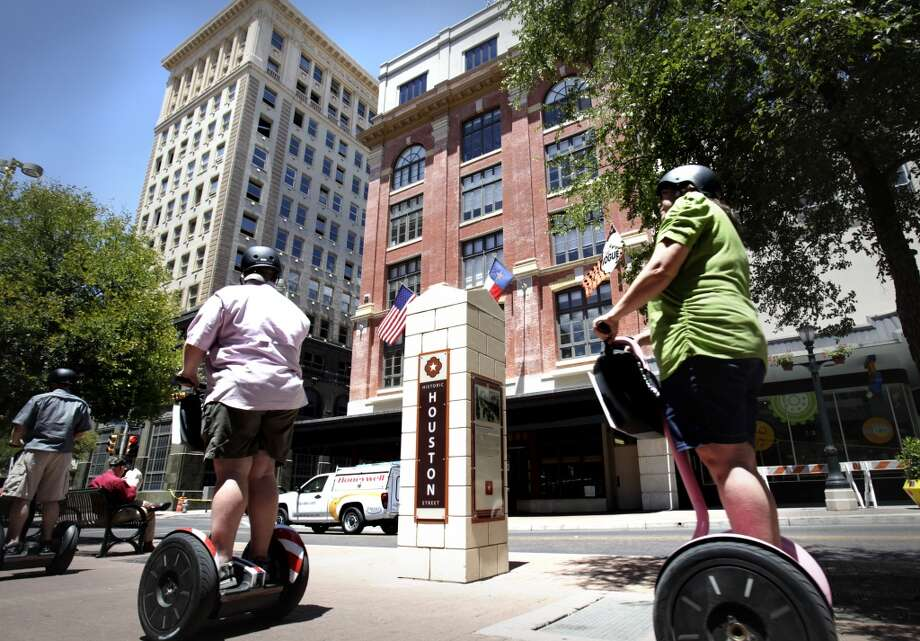 12. SEGWAY TOURS: Nothing says foreplay like parading down sidewalks like nobility — tossing commoners aside — on one of these bad boys. And remember, there are very few activities you can do that make you look like complete idiots. Photo: Bob Owen, Express-News