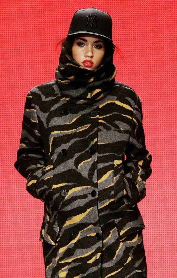 Donna Karan's DKNY coats popped with color, plaid, abstract animal print (pictured here) and black-and-white striped shearling. Photo: Neilson Barnard / Getty Images / 2014 Getty Images