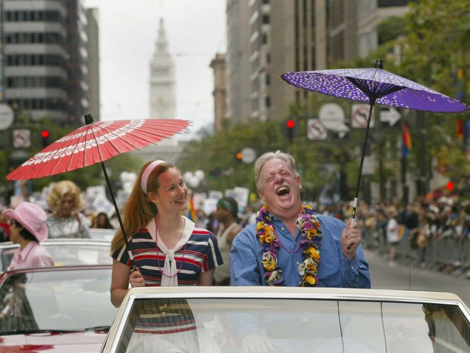 "2003 Parade Grand Marshall Armistead Maupin (who wrote Tales of the City), right, and actress Laura Linney, who starred in ""Tales of the City"". (Liz Mangelsdorf/The Chronicle) Photo: LIZ MANGELSDORF, SFC"
