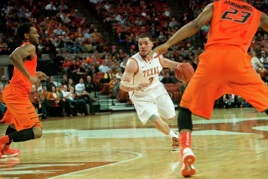 AUSTIN, TX - FEBRUARY 11: Javan Felix #3 of the Texas Longhorns drives to the basket against the Oklahoma State Cowboys on February 11, 2014 at the Frank Erwin Center in Austin, Texas. Photo: Cooper Neill, Getty Images / 2014 Getty Images