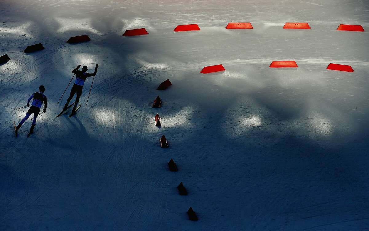 Eric Frenzel of Germany (R) and Akito Watabe of Japan (L) compete during the Nordic Combined Individual Gundersen Normal Hill and 10km Cross Country on day 5 of the Sochi 2014 Winter Olympics at the RusSki Gorki Nordic Combined Skiing Stadium on February 12, 2014 in Sochi, Russia.