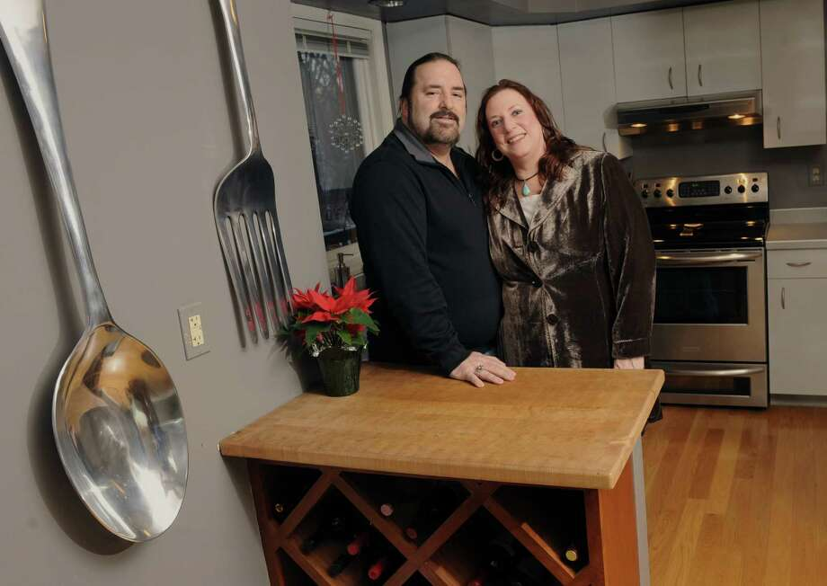 Bret Scott and his wife Karen stand in their kitchen on Tuesday, Feb. 11, 2014 in Waterford, N.Y.  Bret wrote a lovely essay for the food section about he and Karen finding each other and their shared love of cooking. (Lori Van Buren / Times Union) Photo: Lori Van Buren / 00025701A