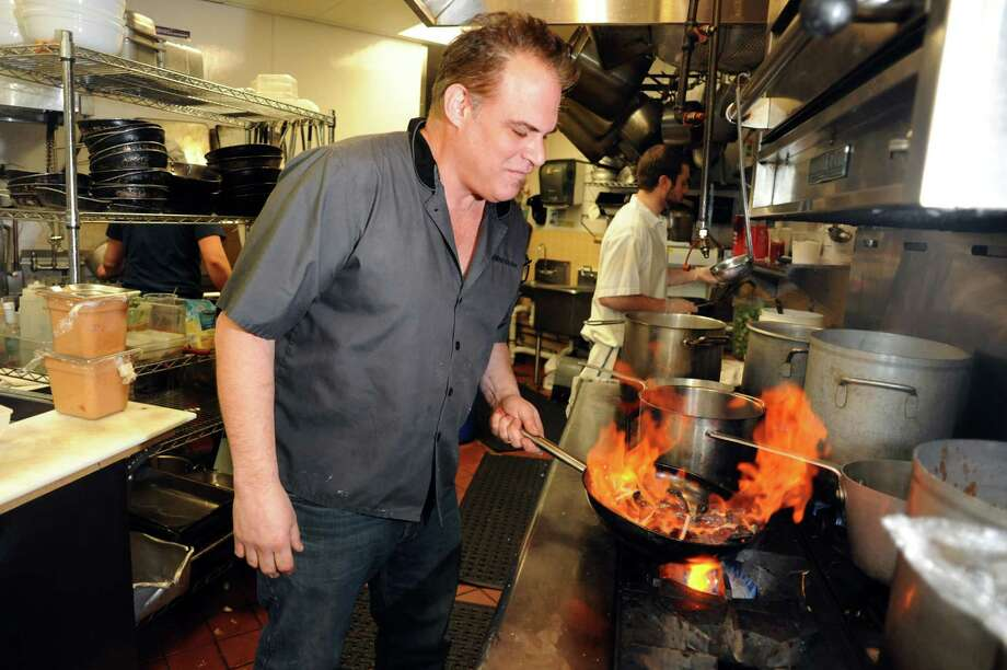 Chef Ric Orlando sautes a mussels dish on Thursday, Feb. 6, 2014, at New World Bistro Bar in Albany, N.Y. (Cindy Schultz / Times Union) Photo: Cindy Schultz / 00025647A
