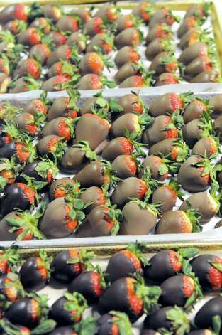 Chocolate dipped strawberries at Uncle Sam's on Friday, Feb. 7, 2014, in Schenectady, N.Y. (Michael P. Farrell/Times Union) Photo: Michael P. Farrell / 00025664A