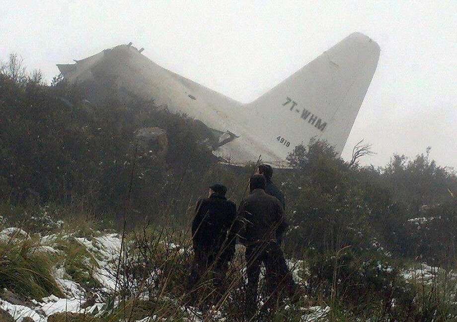 Downed plane:A cell phone photo shows wreckage of a C-130 Hercules aircraft after it crashed into 