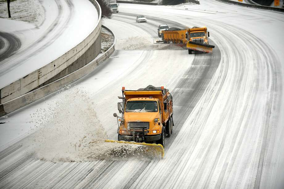 This time, people stayed home:Snowplows clear downtown lanes on Interstate 75/85 during the latest winter storm to hit Atlanta. Unlike the previous storm, which resulted in massive gridlock on snow-packed highways that stranded scores of commuters, few ventured out. Photo: David Tulis, Associated Press