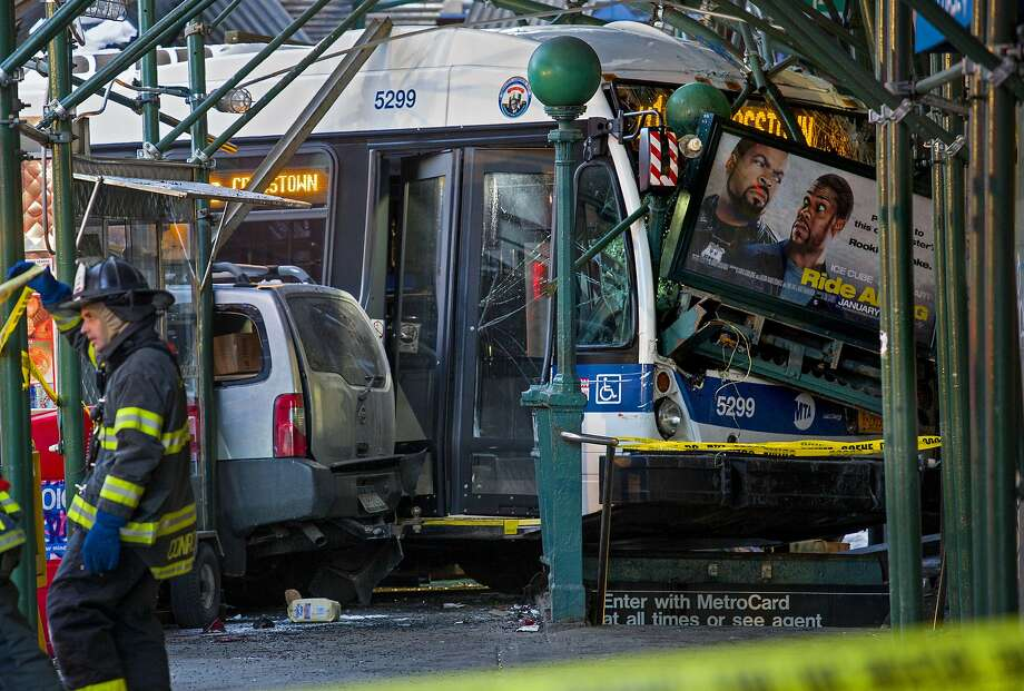 Bus vs. truck: A collision between a Metropolitan Transportation Authority bus and a truck left one person dead and at least four injured next to a subway entrance in Manhattan. Photo: Craig Ruttle, Associated Press
