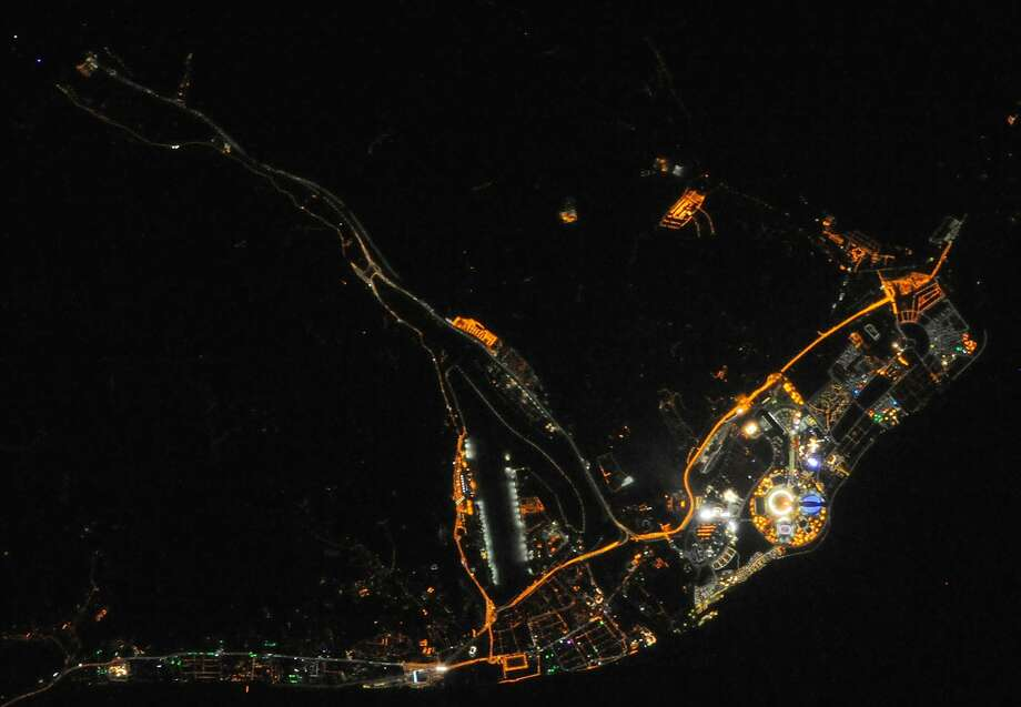 Sochi as seen from orbit:A crew member aboard the International Space Station took this image of of Sochi Olympic Park at night. Fisht Olympic Stadium and the flame are visible at lower right. Photo: Handout, AFP/Getty Images