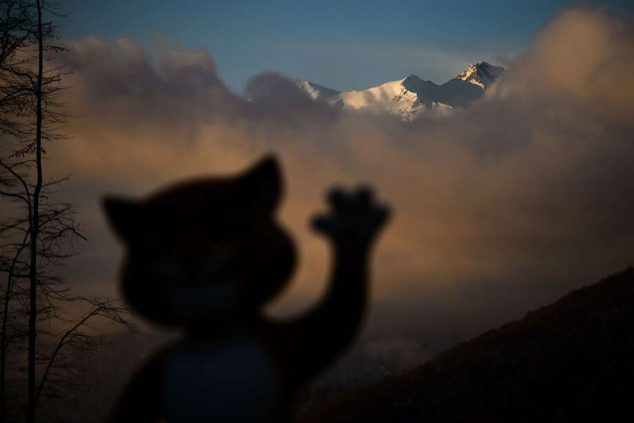 So long, sun! The mascot of Sochi Winter Olympics waves at the sunset from the Mountain Athletes Village. Photo: Fabrice Coffrini, AFP/Getty Images