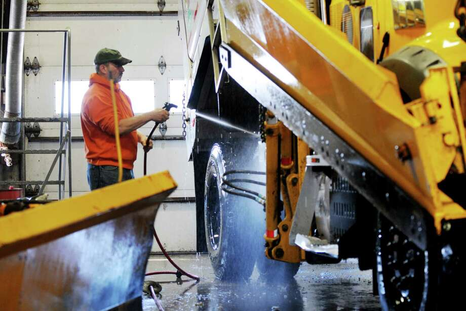 New York State Department of Transportation highway maintenance worker Robert Cocca prepare his snowplow for duty Wednesday afternoon, Feb. 12, 2014, at the state DOT garage on Watervliet Shaker Rd in Colonie, N.Y. DOT crews are getting ready for Thursday's expected snowstorm. (Will Waldron/Times Union) Photo: WW / 00025728A