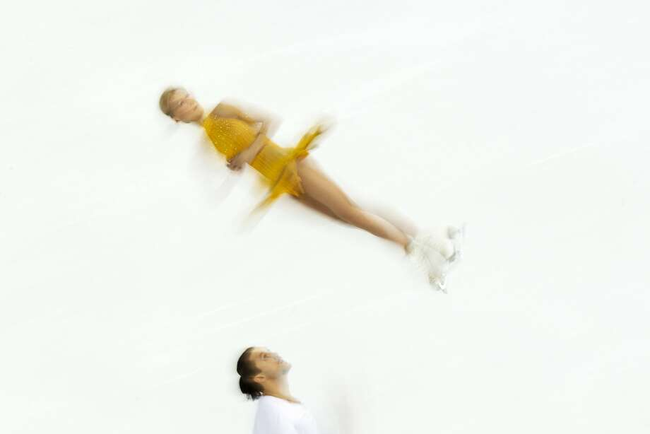 Tatiana Volosozhar and Maxim Trankov of Russia compete in the pairs free skate figure skating competition at the Iceberg Skating Palace during the 2014 Winter Olympics, Wednesday, Feb. 12, 2014, in Sochi, Russia. Photo: Pavel Golovkin, Associated Press