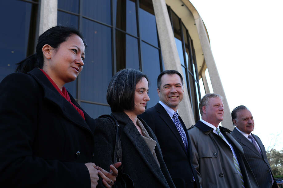 Plaintiffs Cleo DeLeon, from left, with her wife, Nicole Dimetman, and Victor Holmes, with his partner, Mark Phariss, stand with one of their attorneys, Frank Stenger-Castro, far right, as their other attorneys speak to the media after the hearing for their request for a preliminary injunction to declare Texas' ban on same-sex marriage unconstitutional at the John H. Wood, Jr. U.S. Courthouse in San Antonio on Wednesday, Feb. 12, 2014. Photo: LISA KRANTZ, Lisa Krantz / SAN ANTONIO EXPRESS-NEWS