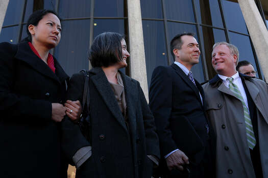 Plaintiffs Cleo DeLeon, from left, with her wife, Nicole Dimetman, and Victor Holmes, with his partner, Mark Phariss, stand behind their attorneys as they speak to the media after the hearing for their request for a preliminary injunction to declare Texas' ban on same-sex marriage unconstitutional at the John H. Wood, Jr. U.S. Courthouse in San Antonio on Wednesday, Feb. 12, 2014. Photo: LISA KRANTZ, Lisa Krantz / SAN ANTONIO EXPRESS-NEWS