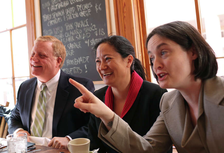 Plaintiffs Mark Phariss, from left, and Cleo DeLeon, with her wife, Nicole Dimetman, have lunch with their legal team at Liberty Bar after the hearing for their request for a preliminary injunction to declare Texas' ban on same-sex marriage unconstitutional at the John H. Wood, Jr. U.S. Courthouse in San Antonio on Wednesday, Feb. 12, 2014. Photo: LISA KRANTZ, SAN ANTONIO EXPRESS-NEWS / SAN ANTONIO EXPRESS-NEWS