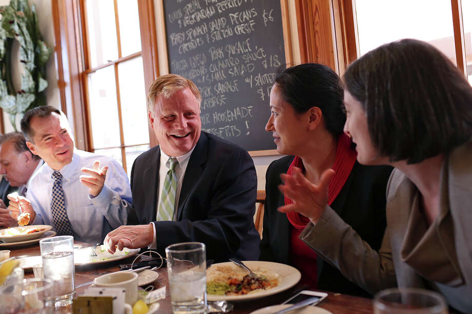 Plaintiffs Victor Holmes, from left, with his partner Mark Phariss, and Cleo DeLeon, with her wife, Nicole Dimetman, have lunch with their legal team at Liberty Bar after the hearing for their request for a preliminary injunction to declare Texas' ban on same-sex marriage unconstitutional at the John H. Wood, Jr. U.S. Courthouse in San Antonio on Wednesday, Feb. 12, 2014. Photo: LISA KRANTZ, SAN ANTONIO EXPRESS-NEWS / SAN ANTONIO EXPRESS-NEWS