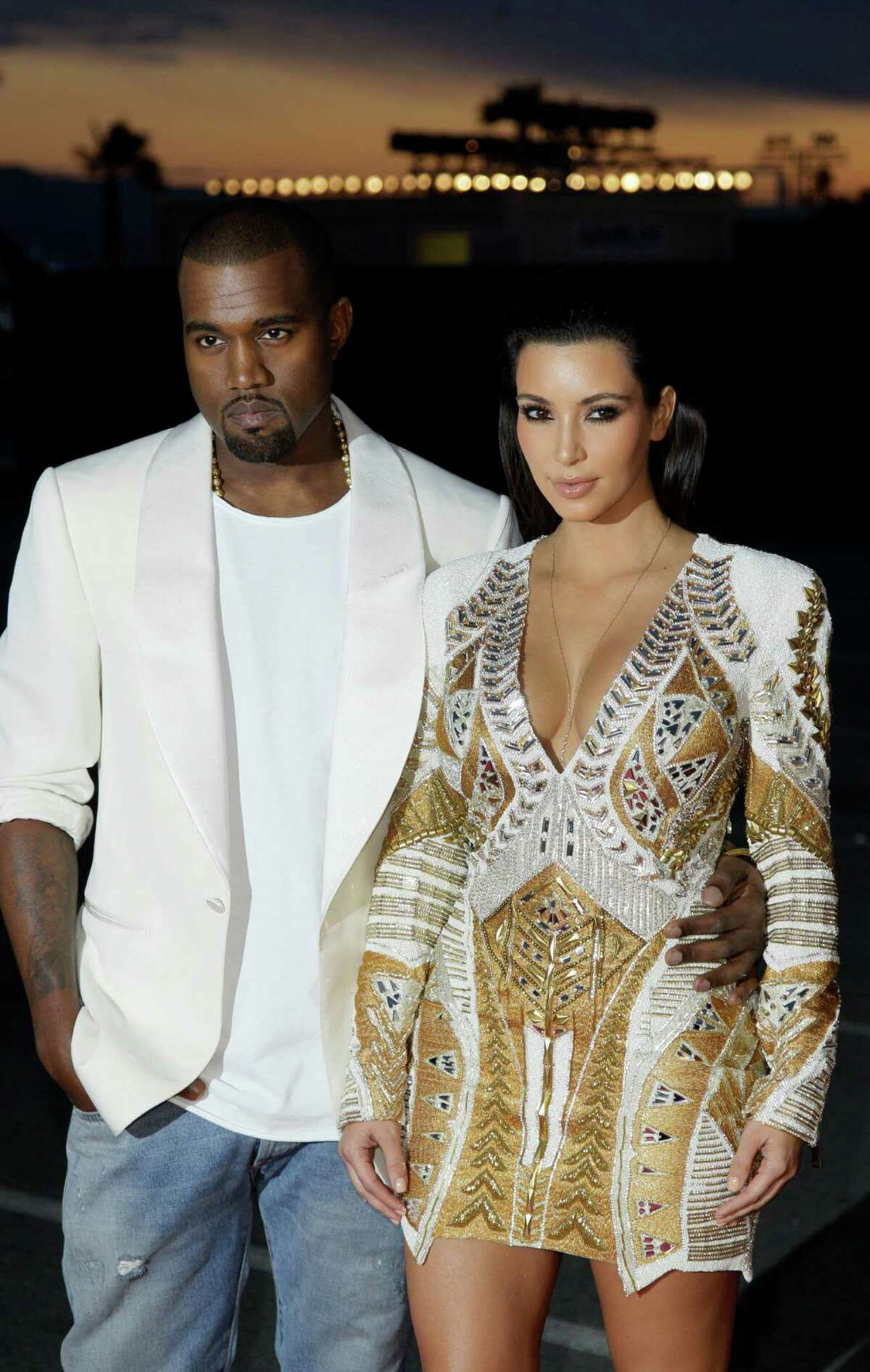 FILE - In this May 23, 2012 file photo, singer Kanye West, left, and television personality Kim Kardashian arrive for the screening of