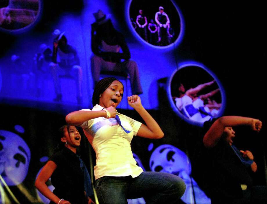 Times Union photo by Cindy Schultz -- Quinasia Quattlebaum, 13, of Albany dances with the Myers Step Team during the 3rd annual Black History Step Show on Friday, Feb.9, 2007, at the Palace Theatre in Albany, N.Y. (STANDALONE) Photo: CINDY SCHULTZ / ALBANY TIMES UNION
