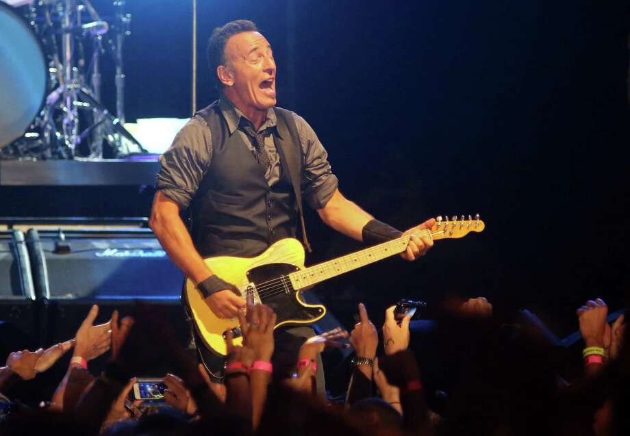 FILE - In this Sunday, Jan. 26, 2014, file photo, American performer Bruce Springsteen sings during his live performance in Cape Town, South Africa. Springsteen announced a new set of U.S. tour dates Monday, Feb. 10, 2014, after finishing recent treks in South Africa, Australia and New Zealand. Springsteen and the E Street Band will kick off the 15-date tour April 8 in Cincinnati. His new tour will visit Nashville, Tenn., Atlanta, Tampa, Fla., and Houston, among other cities. (AP Photo/Schalk van Zuydam, File) ORG XMIT: NY123 Photo: Schalk Van Zuydam / AP