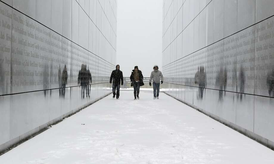 Frigid temperatures such as those endured by these visitors to Liberty State Park in Jersey City, N.J., last month, could trigger strokes, according to a new research study. Photo: Julio Cortez, Associated Press