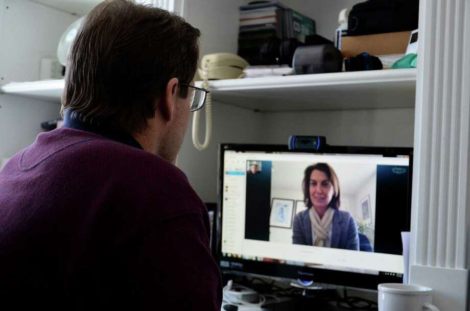 Joel Pelzner talks to Bethany Zaro, New Canaan's public health nurse, via Skype on Feb. 12, 2014. Pelzner is one of 63 seniors participating of this year's Tele-Health program pilot. Photo: Nelson Oliveira / New Canaan News