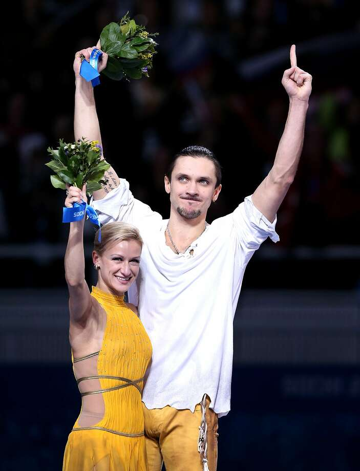 SOCHI, RUSSIA - FEBRUARY 12:  Gold medalists Tatiana Volosozhar and Maxim Trankov of Russia celebrate on the podium during the flower ceremony for the Figure Skating Pairs event during day five of the 2014 Sochi Olympics at Iceberg Skating Palace on February 12, 2014 in Sochi, Russia.  (Photo by Matthew Stockman/Getty Images) Photo: Matthew Stockman, Getty Images