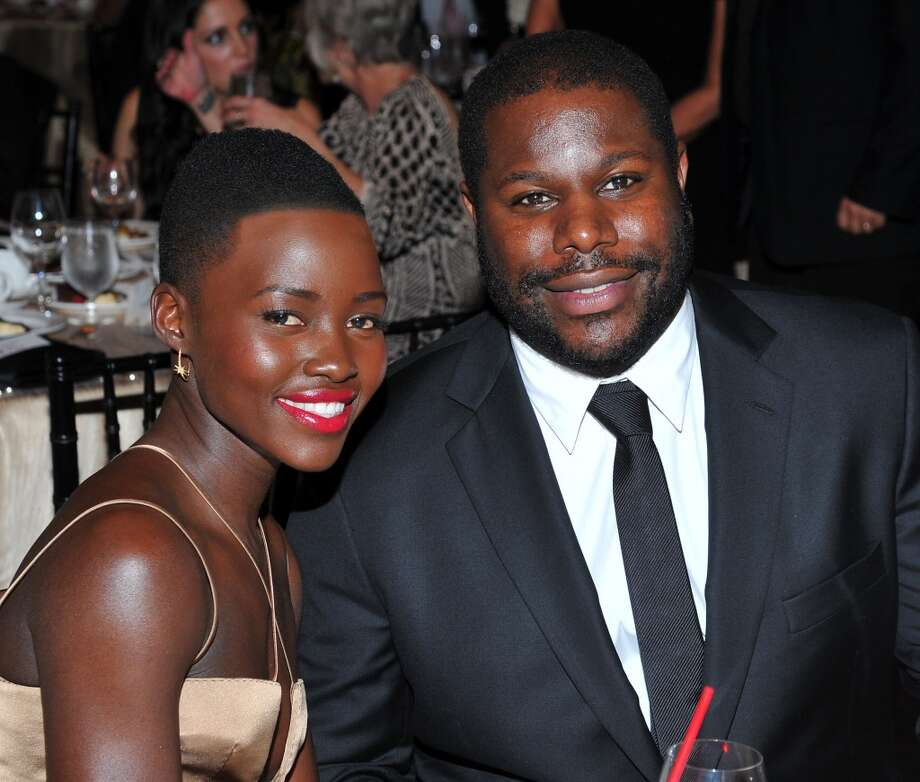 Actress Lupita Nyong'o, left, and director Steve McQueen are seen at the 2014 AARP's Movies for Grownups Gala, on Monday, Feb. 10th, 2014 in Beverly Hills, Calif. (Photo by Vince Bucci/Invision for AARP Media/AP Images) Photo: Vince Bucci, Associated Press