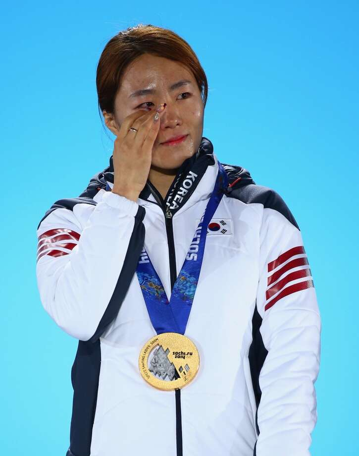 Gold medalist Sang Hwa Lee of South Korea celebrates during the medal ceremony for the Women's 500m on day five of the Sochi 2014 Winter Olympics at Medals Plaza on February 12, 2014 in Sochi, Russia.  (Photo by Paul Gilham/Getty Images) Photo: Paul Gilham, Getty Images