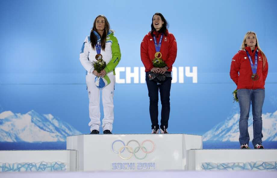 Women's downhill medalists, from left, Slovenia's Tina Maze and Switzerland's Dominique Gisin, who tied for the gold, and Switzerland's Lara Gut, who finished third for the bronze, pose with their medals at the 2014 Winter Olympics in Sochi, Russia, Wednesday, Feb. 12, 2014. (AP Photo/Morry Gash) Photo: Morry Gash, Associated Press