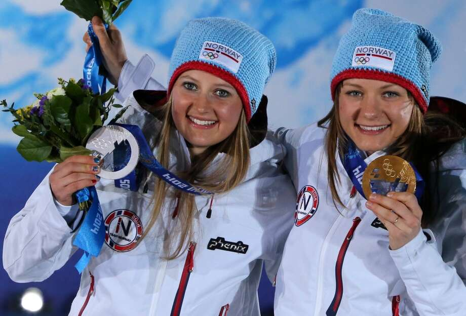 Norway's silver medalist Ingvild Flugstad Oestberd and Norway's gold medalist Maiken Caspersen Falla pose during the Women's Cross-Country Skiing 10km Classic Medal Ceremony at the Sochi medals plaza during the Sochi Winter Olympics on February 13, 2014.  LOIC VENANCE/AFP/Getty Images Photo: LOIC VENANCE, AFP/Getty Images