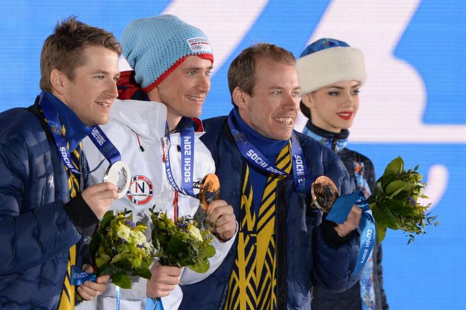 (From L) Sweden's silver medalist Teodor Peterson, Norway's gold medalist Ola Vigen Hattestad and Sweden's bronze medalist Emil Joensson pose during the Men's Cross-Country Skiing Individual Sprint Free Medal Ceremony at the Sochi medals plaza during the Sochi Winter Olympics on February 12, 2014.  AFP PHOTO / LOIC VENANCELOIC VENANCE/AFP/Getty Images Photo: LOIC VENANCE, AFP/Getty Images