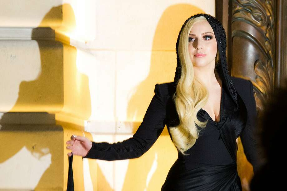 FILE - In this Jan. 19, 2014 file photo, Lady Gaga arrives to attend the Atelier Versace Spring-Summer 2014 Haute Couture fashion collection, presented in Paris. Tourists are giving way to dancers as a production crew takes over Hearst Castle on the California coast, where Lady Gaga is shooting a big-budget music video. The pop diva had yet to be seen as crewmembers carried in bags full of fake flowers and a giant plaster seashell Tuesday, Feb. 11, 2014. (AP Photo/Zacharie Scheurer, file) Photo: Zacharie Scheurer, Associated Press