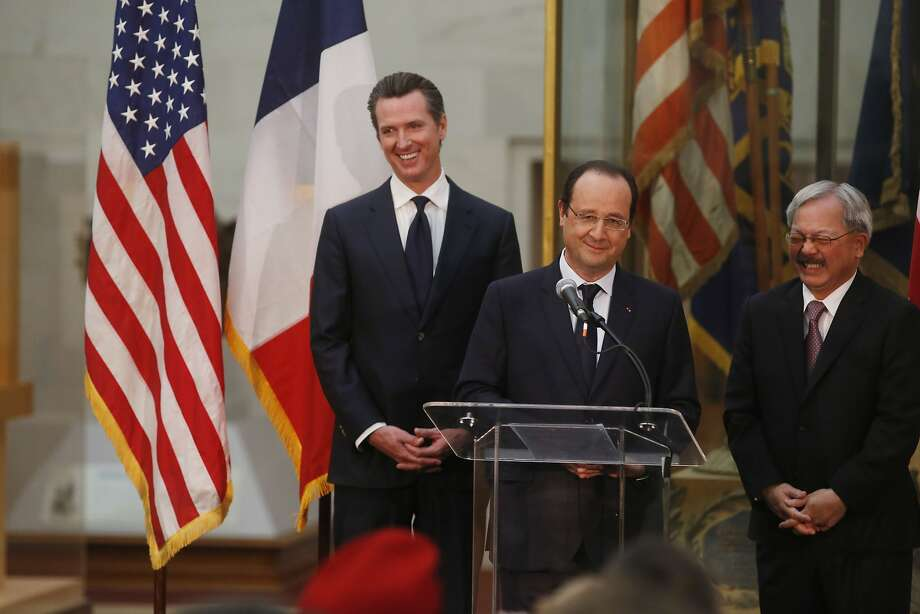 Flanked by Lt. Governor Gavin Newsom and Mayor Ed Lee, French President Francois Hollande (center) speaks a tech collaboration with the city during a one day stop at City Hall on Wednesday Feb. 12, 2014 in San Francisco, Calif. Photo: Mike Kepka, The Chronicle